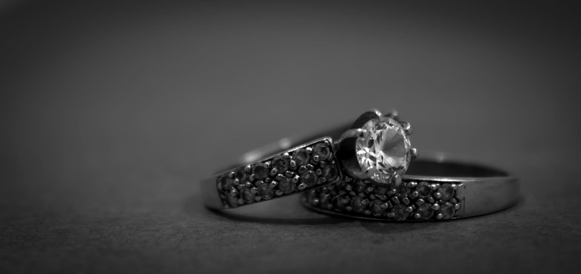 engagement ring set with gray background