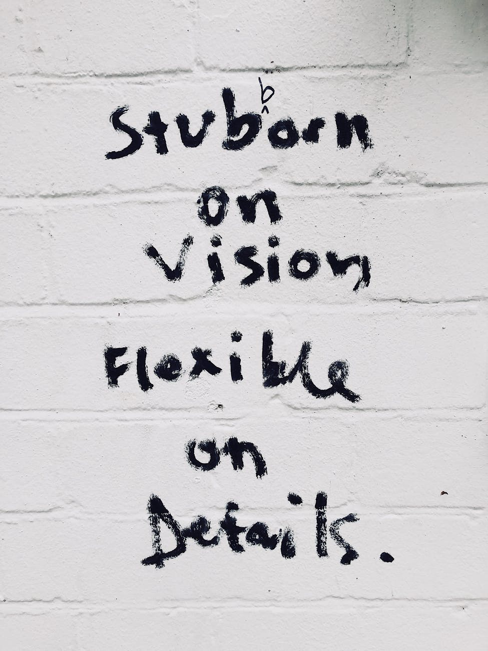 text on wall stubborn on vision flexible on details