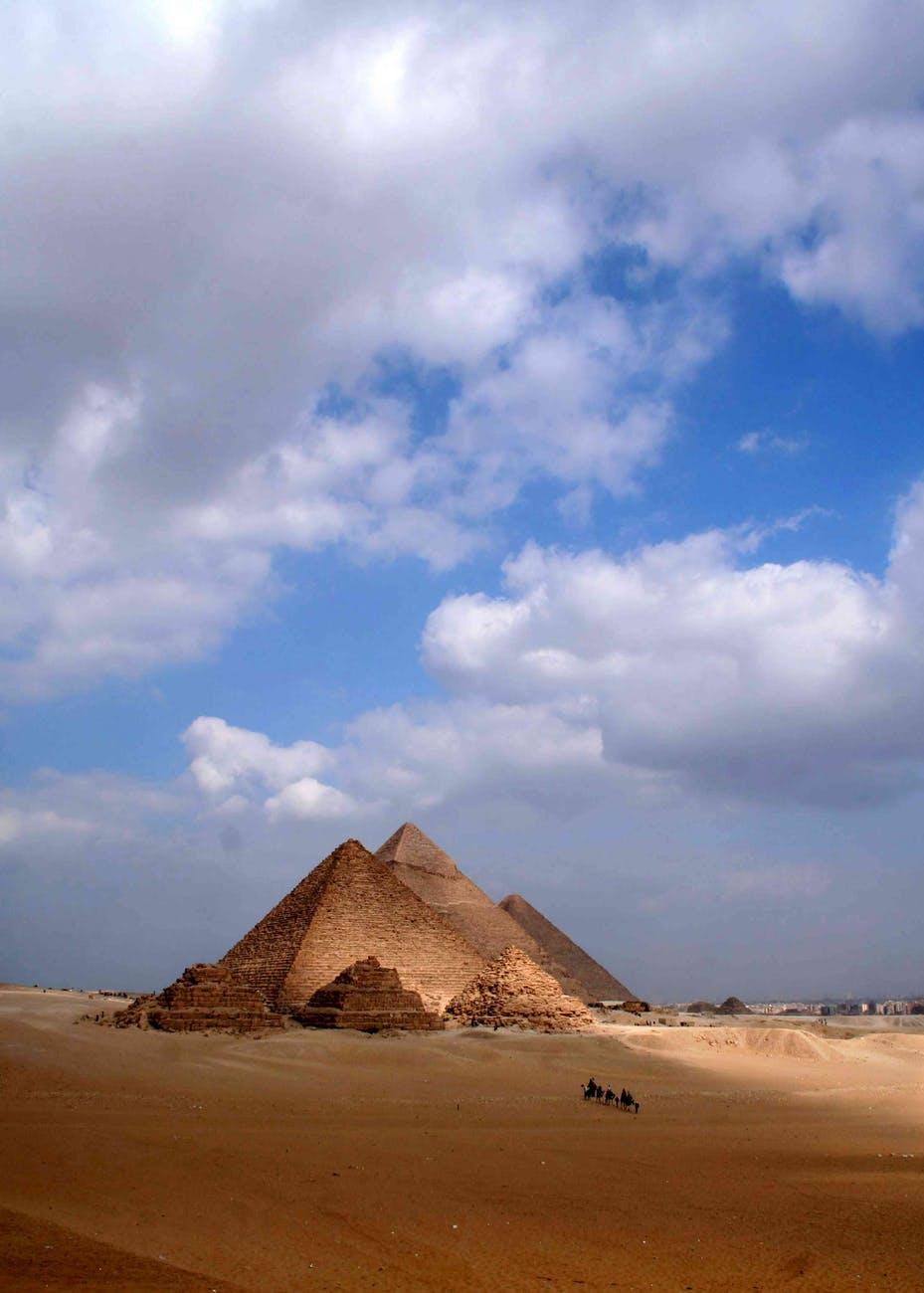 Egyptian pyramids with camel caravan