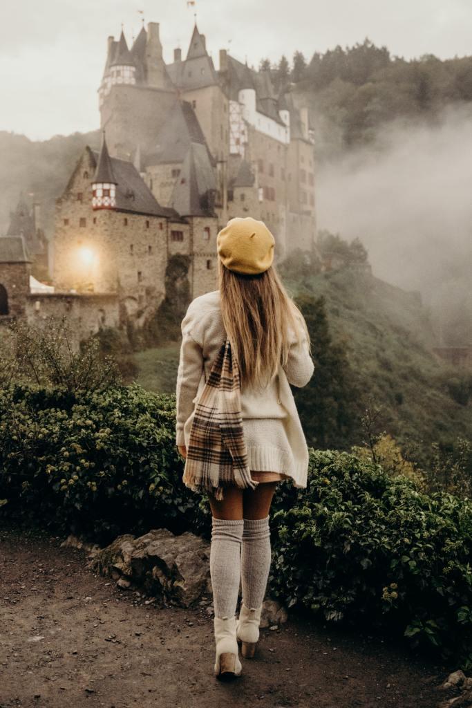 Girl walking toward misty castle